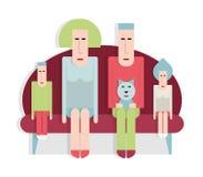 Семья на софе Стоковые Фото