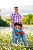 Семья на лужке Стоковая Фотография RF