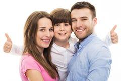 Семья показывая большие пальцы руки вверх стоковые фото