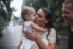 Семья под дождем Стоковое фото RF