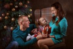 Семья празднуя рождество Стоковые Фотографии RF