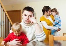 Семья при дети имея ссору дома Стоковая Фотография RF