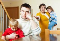 Семья при 2 дет имея ссору Стоковые Изображения RF