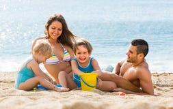 семья 4 пляжа Стоковые Изображения