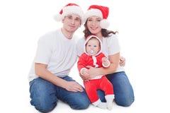 Семья рождества смотря камеру Стоковое Изображение RF