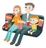 Семья сидя в кино и смотря кино Стоковое Фото