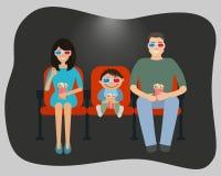 Семья смотря кино в кино Стоковое Фото