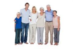 Семья стоя против белой предпосылки стоковая фотография rf