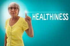 Сенсорный экран Healthiness показанный старшей концепцией стоковые фото