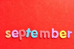 Сентябрь на красной предпосылке Стоковое Фото