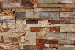 Серая, белая и коричневая кирпичная стена гранита Стоковые Изображения