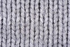 Серая вязать текстура шерстей Стоковые Изображения