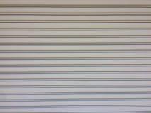 Серая дверь ролика, предпосылка текстуры двери штарки бесплатная иллюстрация