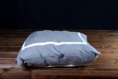 серая изолированная подушка Стоковое фото RF