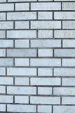 Серая кирпичная стена для предпосылки и текстуры Стоковые Изображения RF