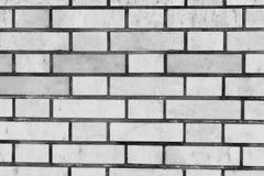 Серая кирпичная стена для предпосылки и текстуры Стоковые Изображения