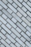 Серая кирпичная стена для предпосылки и текстуры Стоковые Фотографии RF