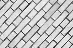 Серая кирпичная стена для предпосылки и текстуры Стоковая Фотография RF