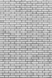 Серая кирпичная стена для предпосылки и текстуры Стоковые Фото
