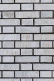 Серая кирпичная стена для предпосылки и текстуры Стоковое Изображение RF