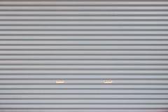 Серая предпосылка двери гаража Стоковое Фото