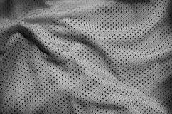Серая предпосылка текстуры ткани одежды спорта Взгляд сверху серой поверхности ткани ткани Темная рубашка баскетбола стоковое фото rf
