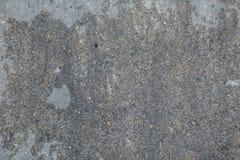 Серая предпосылка с малыми камнями Стоковая Фотография