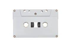 серая пластичная магнитофонная кассета изолированная на белизне Стоковые Изображения