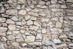 Серая рука построила каменную стену Стоковое Фото