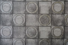 Серая стена цемента с квадратом цацы и текстурой круга от предпосылки Стоковая Фотография