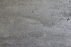 Серая сырцовая конкретная стена цемента для предпосылок стоковое фото