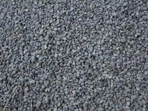 Серая текстура гравия - предпосылка гранита каменная стоковая фотография rf