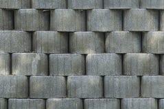 Серая текстурированная предпосылка с круглыми объектами Луковичная, грубая поверхность Большая серая стена с много объектов Стоковое фото RF