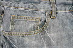 Серая ткань джинсов с карманн Стоковая Фотография RF