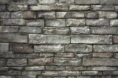 серая штабелированная стена камней стоковые изображения