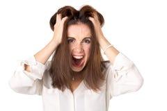 Сердитая вскользь молодая женщина стоковая фотография