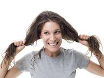 Сердитая женщина имея плохой день волос стоковые изображения rf