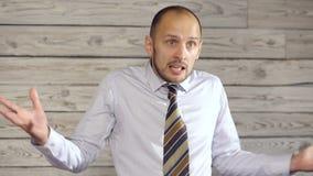 Сердитый бизнесмен клянется сток-видео