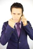 Сердитый бизнесмен на телефоне Стоковое Фото