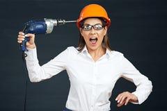 Сердитый инструмент сверла удерживания бизнес-леди Стоковые Изображения RF