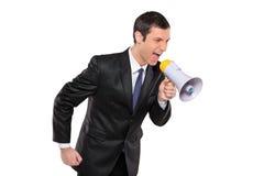сердитый мегафон бизнесмена крича через Стоковые Изображения RF