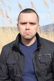 сердитый портрет человека Стоковые Изображения