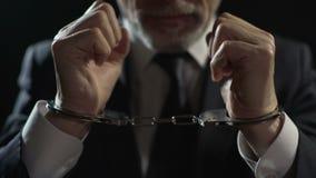 Сердитый преступник заключенный в турьму в наручниках, несправедливый бизнесмен наказанный для обиды сток-видео