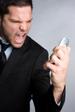 сердитый телефон человека Стоковые Изображения RF