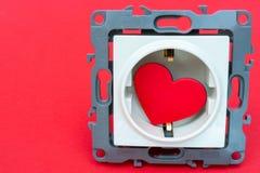 Сердце в электрическом гнезде - открытка дня Валентайн стоковая фотография rf
