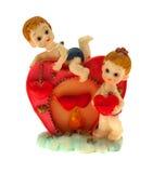 сердце детей около красного цвета к стоковая фотография