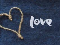 Сердце знака шпагата в джинсовой ткани Стоковые Изображения RF