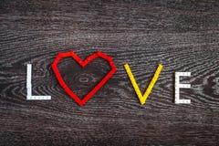 Сердце и влюбленность пластичных кирпичей Стоковое фото RF