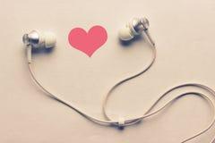 Сердце и наушники Стоковая Фотография
