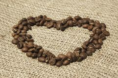 Сердце кофе на холстине Стоковые Изображения RF